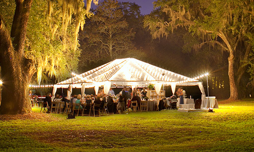 Simple white tent in a field lit up beautifully at night with white lights. & Event Rentals - Hicks Event and Convention Rentals u0026 Services