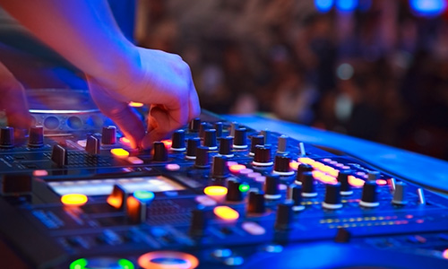 A professional mixer controls the sound at this event.