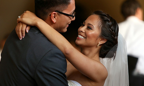 A happy couple dance at their wedding planned with Hicks Special Events.