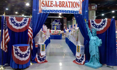 A patriotic-themed custom trade show display set up by Hicks staff.