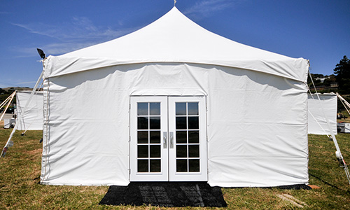 Simple white tent with glass French doors.
