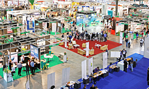 An overhead view of a vast trade show in progress,