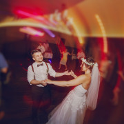 A couple dancing at their wedding.