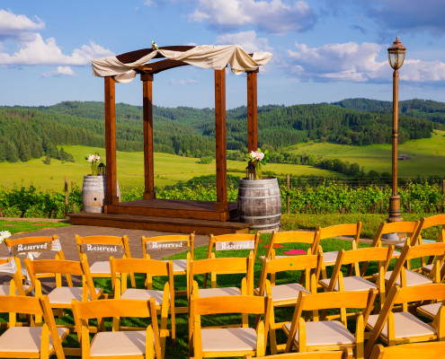 An altar and chairs set up for an outside summer wedding.
