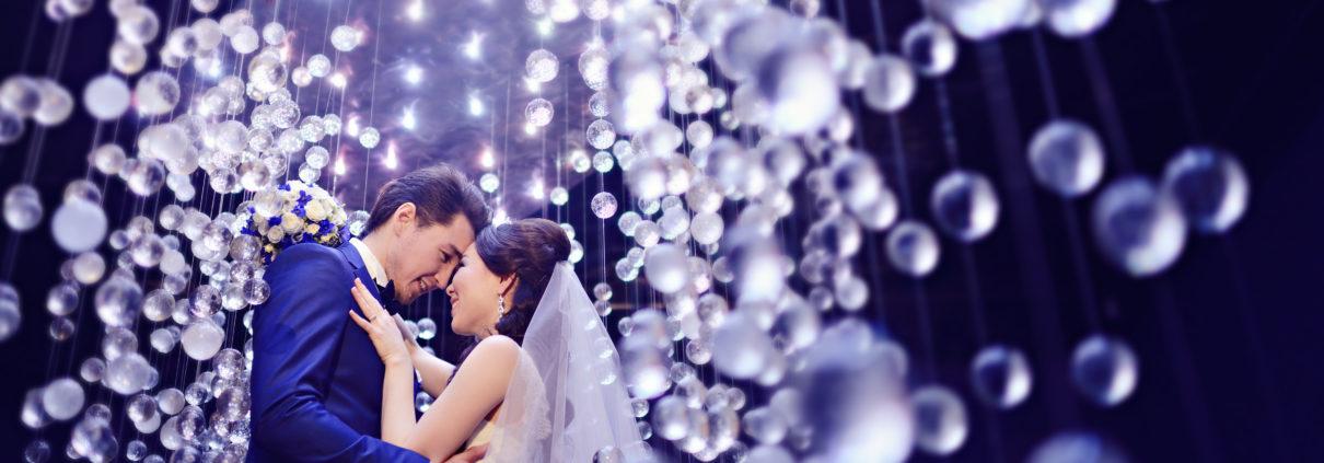 Married couple in atmospheric lighting.