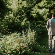 Image of wedding couple walking down a path.