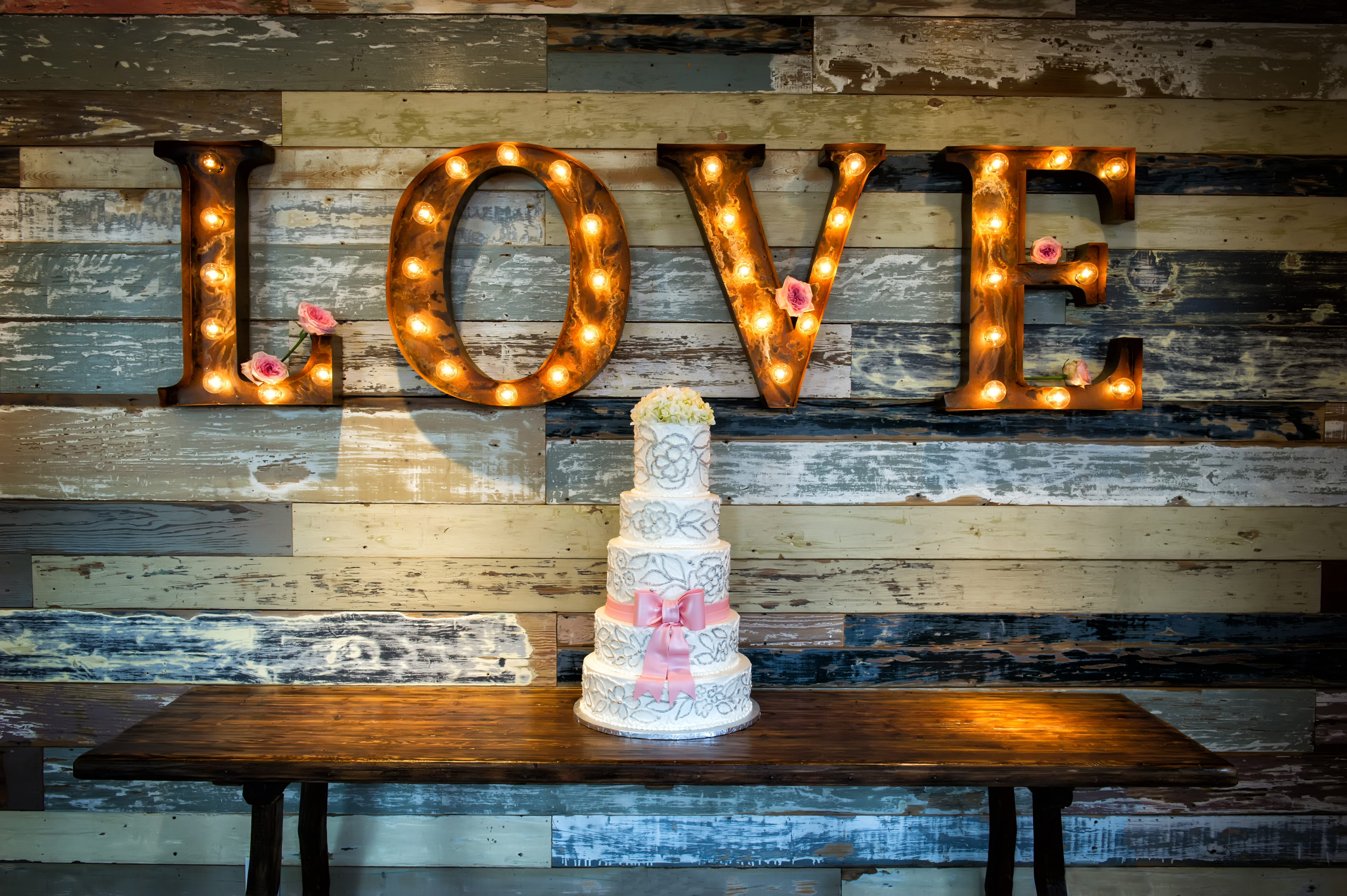 """An example of gobo lighting, with the lights shining through the word """"love""""."""