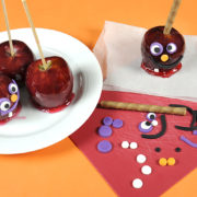 An image of candy apples and the Halloween-themed decorations meant to go on them.
