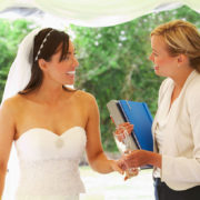 Smiling Bride with Wedding Coordinator at her side